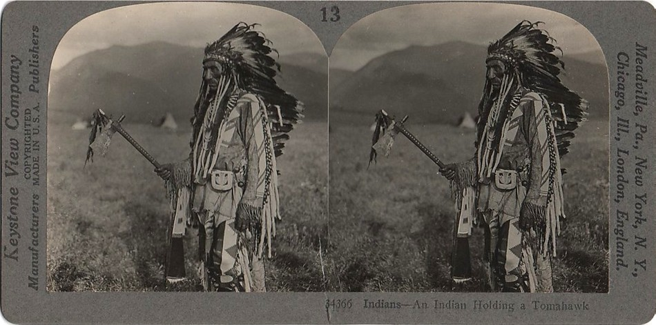 1910 Indian holding a Tomahawk